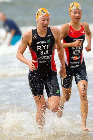 Daniela Ryf, Rachel Klamer - 2012 Subaru Mooloolaba Women's ITU Triathlon World Cup; Mooloolaba, Sunshine Coast, Queensland, Australia; 25 March 2012. Photos by Des Thureson - disci.smugmug.com.  Swim Leg Surf Exit.