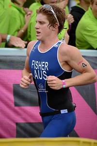 Ryan Fisher - Run Leg - 2012 Noosa Triathlon, Noosa Heads, Sunshine Coast, Queensland, Australia; 4 November 2012. Photos by Des Thureson. Camera 1.