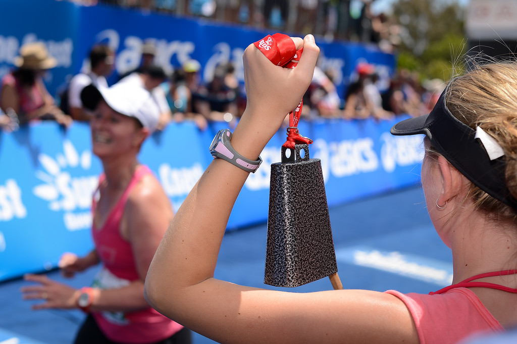 Run Leg - The Cow Bell in Action - Approaching the Finishing Line - Run Leg - 2012 Noosa Triathlon, Noosa Heads, Sunshine Coast, Queensland, Australia; 4 November 2012. Photos by Des Thureson. Camera 1.