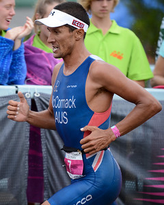 "Two times Hawaii Ironman World Champion Chris McCormack (""Macca"") - Run Leg - 2012 Noosa Triathlon, Noosa Heads, Sunshine Coast, Queensland, Australia; 4 November 2012. Photos by Des Thureson. Camera 1."