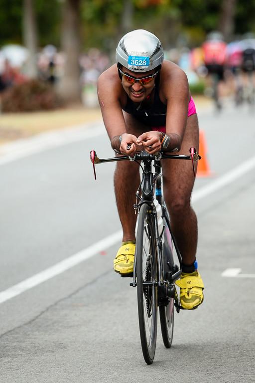Gi Singh - Bike Leg - 2012 Noosa Triathlon, Noosa Heads, Sunshine Coast, Queensland, Australia; 4 November 2012. Photos by Des Thureson. Camera 2.