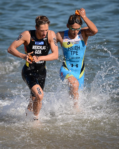 Justus Nieschlag, Shen-yen Hsieh - Subaru Mooloolaba Men's ITU Triathlon World Cup - Mooloolaba Multi Sport Festival Super Saturday, 15 March 2014 - Mooloolaba, Sunshine Coast, Queensland, Australia. Photos by Des Thureson - http://disci.smugmug.com - Camera 1.