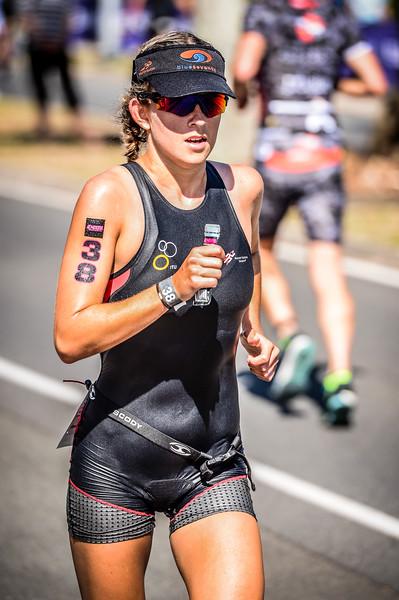 "Alternate Processing: ""HDR Look Strong"" - Laura Cook - Run Leg - 2016 Noosa Triathlon, Noosa Heads, Sunshine Coast, Queensland, Australia; 30 October. Camera 2. Photos by Des Thureson - disci.smugmug.com"