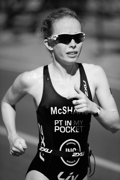 """Orange Filter"" - Charlotte McShane - Run Leg - 2016 Noosa Triathlon, Noosa Heads, Sunshine Coast, Queensland, Australia; 30 October. Camera 2. Photos by Des Thureson - disci.smugmug.com"