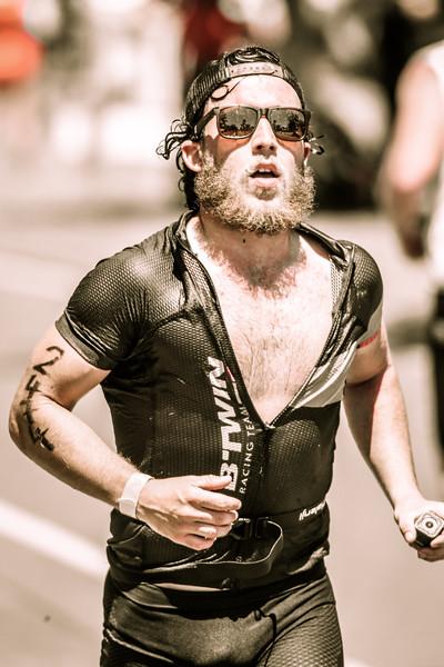 Alternate Processing: The 300 Movie Look - Run Leg - 2016 Noosa Triathlon, Noosa Heads, Sunshine Coast, Queensland, Australia; 30 October. Camera 1. Photos by Des Thureson - disci.smugmug.com