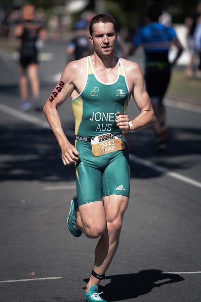 "Alternate Processing: ""Ultimate Fighter (Medium)"" - Harry Jones - Run Leg - 2016 Noosa Triathlon, Noosa Heads, Sunshine Coast, Queensland, Australia; 30 October. Camera 2. Photos by Des Thureson - disci.smugmug.com"