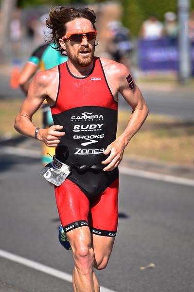Alternate Processing: Matt's Dramatic Sky Level 3 -  Dan Wilson - Run Leg - 2016 Noosa Triathlon, Noosa Heads, Sunshine Coast, Queensland, Australia; 30 October. Camera 2. Photos by Des Thureson - disci.smugmug.com