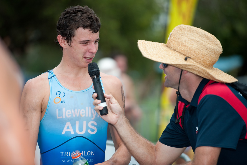 Interview for the audience - Scott Llewellyn - 2011 Caloundra Enduro Triathlon for professional triathletes (men's event); Woorim Park, Golden Beach, Caloundra, Sunshine Coast, Queensland, Australia; 6 February 2011. Photos by Des Thureson.