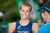 Race Winner Jesse Featonby is interviewed by the media- 2011 Caloundra Enduro Triathlon for professional triathletes (men's event); Woorim Park, Golden Beach, Caloundra, Sunshine Coast, Queensland, Australia; 6 February 2011. Photos by Des Thureson.