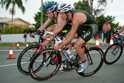 Josh Maeder  (closer) and Michael Gosman - 2011 Caloundra Enduro Triathlon for professional triathletes (men's event); Woorim Park, Golden Beach, Caloundra, Sunshine Coast, Queensland, Australia; 6 February 2011. Photos by Des Thureson.
