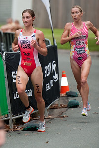 Lauren Campbell followed by Liz Blatchford - 2011 Caloundra Women's Enduro Triathlon for professional triathletes; Woorim Park, Golden Beach, Caloundra, Sunshine Coast, Queensland, Australia; 6 February 2011. Photos by Des Thureson.