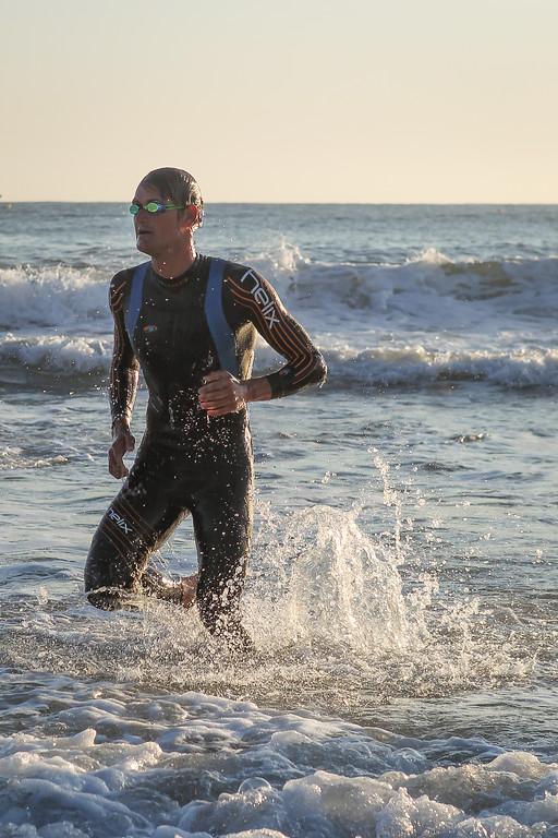 "Clayton Fettell - Swim Exit, approaching T1 - Swim Leg - Ironman 70.3 Sunshine Coast 2013; Mooloolaba, Queensland, Australia. Camera 2. Photos by Des Thureson - <a href=""http://disci.smugmug.com"">http://disci.smugmug.com</a>."