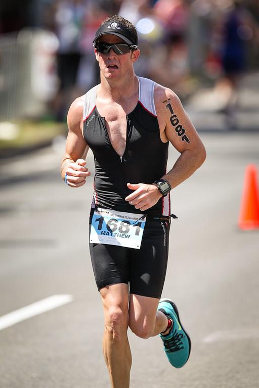 """Matt Herbert - Run Leg - Ironman 70.3 Sunshine Coast 2013; Mooloolaba, Queensland, Australia. Camera 2. Photos by Des Thureson - <a href=""""http://disci.smugmug.com"""">http://disci.smugmug.com</a>."""
