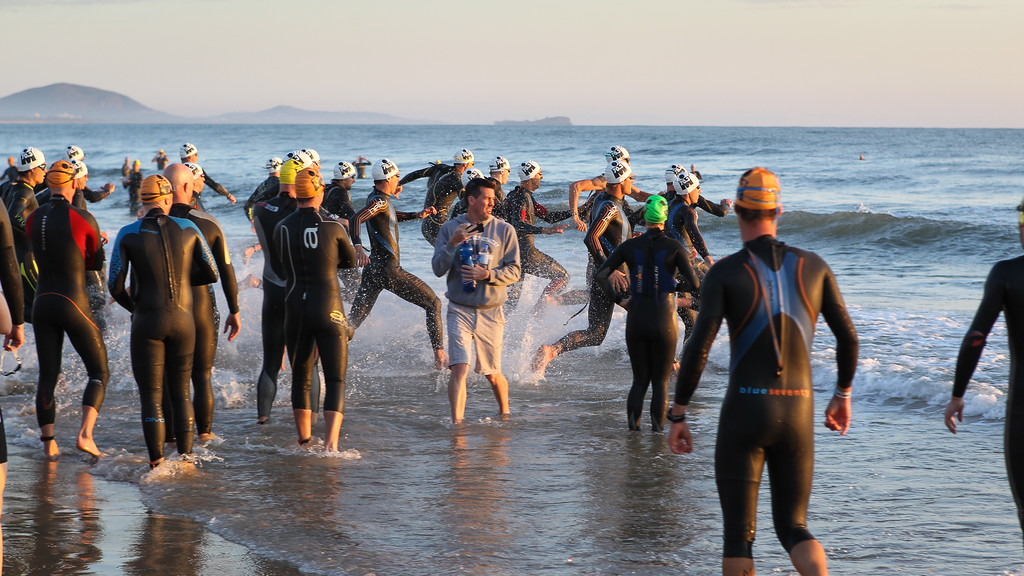 """Race Start - Swim Leg - Ironman 70.3 Sunshine Coast 2013; Mooloolaba, Queensland, Australia. Camera 2. Photos by Des Thureson - <a href=""""http://disci.smugmug.com"""">http://disci.smugmug.com</a>."""