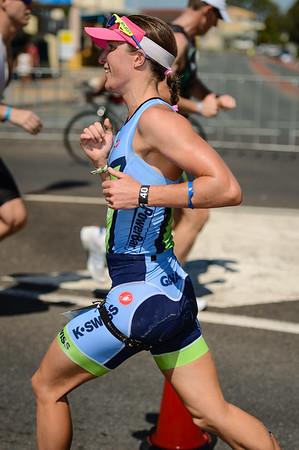 Gina Crawford (Women's Pro Winner) - Run Leg - Ironman 70.3 Sunshine Coast 2013; Mooloolaba, Queensland, Australia. Camera 1. Photos by Des Thureson - http://disci.smugmug.com.