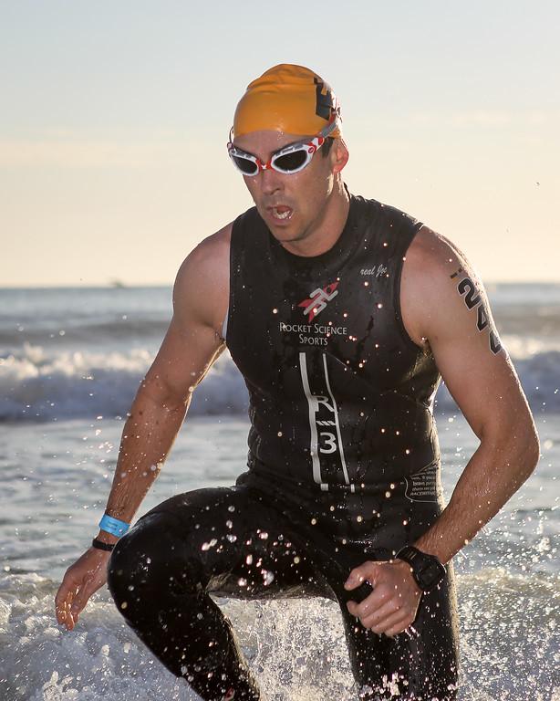 "Swim Exit, approaching T1 - Swim Leg - Ironman 70.3 Sunshine Coast 2013; Mooloolaba, Queensland, Australia. Camera 2. Photos by Des Thureson - <a href=""http://disci.smugmug.com"">http://disci.smugmug.com</a>."
