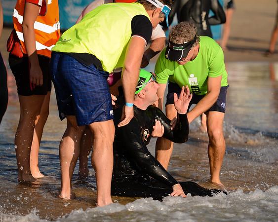 Swim Exit (Coral Sea, Mooloolaba), Swim Leg - Ironman 70.3 Sunshine Coast 2013; Mooloolaba, Queensland, Australia. Camera 1. Photos by Des Thureson - http://disci.smugmug.com.