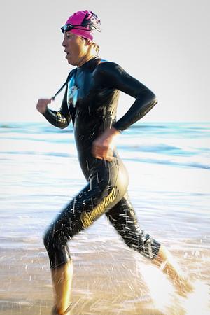 Kiyomi Niwata - Swim Exit, approaching T1 - Swim Leg - Ironman 70.3 Sunshine Coast 2013; Mooloolaba, Queensland, Australia. Camera 2. Photos by Des Thureson - http://disci.smugmug.com.