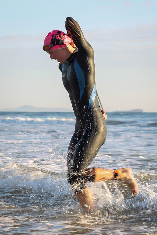 "Gina Crawford - Swim Exit, approaching T1 - Swim Leg - Ironman 70.3 Sunshine Coast 2013; Mooloolaba, Queensland, Australia. Camera 2. Photos by Des Thureson - <a href=""http://disci.smugmug.com"">http://disci.smugmug.com</a>."