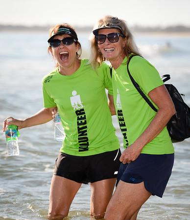 Volunteers - Swim Exit (Coral Sea, Mooloolaba), Swim Leg - Ironman 70.3 Sunshine Coast 2013; Mooloolaba, Queensland, Australia. Camera 1. Photos by Des Thureson - http://disci.smugmug.com.