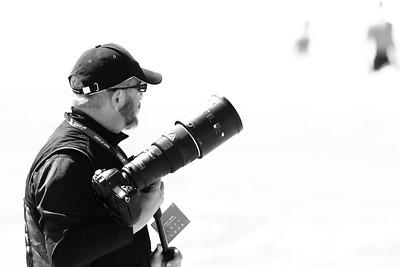 alternate processing, red hi contrast filter - ITU Photographer Delly Carr - 2015 Mooloolaba ITU Triathlon World Cup Men - 2015 Mooloolaba Triathlon Multi Sport Festival, Sunshine Coast, Qld, AUS; Saturday 14 March 2015. Photos by Des Thureson - http://disci.smugmug.com. Camera 2.
