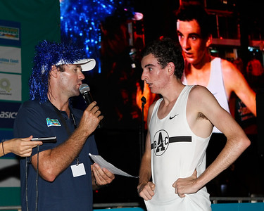 Men's race winner Patrick Tiernan (on the big screen as well) - 2012 ASICS Twilight 5km Run; Mooloolaba, Sunshine Coast, Queensland, Australia; 23 March 2012. Photos by Des Thureson - disci.smugmug.com.