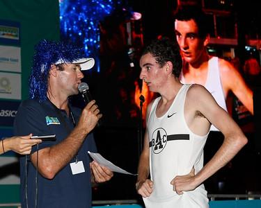 Men's race winner Patrick Tiernan (on the big screen as well) - 2012 ASICS Twilight 5km Run; Mooloolaba, Sunshine Coast, Queensland, Australia; 23 March 2012. Photos by Des Thureson - disci.smugmug.com.