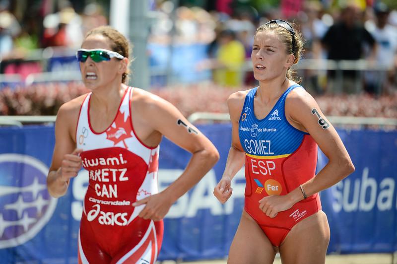 """Amelie Kretz, Tamara Gomez Garrido - 2015 Mooloolaba ITU Triathlon World Cup Women - 2015 Mooloolaba Triathlon Multi Sport Festival, Sunshine Coast, Qld, AUS; Saturday 14 March 2015. Photos by Des Thureson - <a href=""""http://disci.smugmug.com"""">http://disci.smugmug.com</a>. Camera 1."""