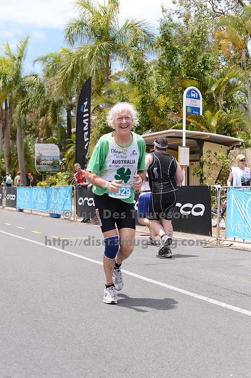 """80 Year Old Markus Hanley - Run Leg - 2012 Noosa Triathlon, Noosa Heads, Sunshine Coast, Queensland, Australia; 4 November 2012. Photos by Des Thureson. Camera 1. - The images in this gallery have not been edited / cropped. If you purchase* a print or download, these images will be edited / corrected / cropped before being sent out. *Ordering will be via <a href=""""http://disci.photoshelter.com"""">http://disci.photoshelter.com</a> or via email. Thanks, Des."""