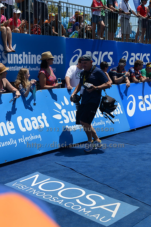 """Run Leg - Barry Alsop, Photographer - Approaching the Finishing Line - Run Leg - 2012 Noosa Triathlon, Noosa Heads, Sunshine Coast, Queensland, Australia; 4 November 2012. Photos by Des Thureson. Camera 1. - The images in this gallery have not been edited / cropped. If you purchase* a print or download, these images will be edited / corrected / cropped before being sent out. *Ordering will be via <a href=""""http://disci.photoshelter.com"""">http://disci.photoshelter.com</a> or via email. Thanks, Des."""