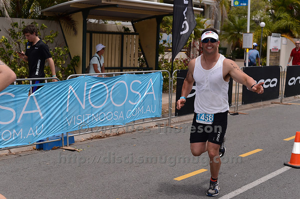 """Determined to finish with his brother - Nice Job! - Run Leg - 2012 Noosa Triathlon, Noosa Heads, Sunshine Coast, Queensland, Australia; 4 November 2012. Photos by Des Thureson. Camera 1. - The images in this gallery have not been edited / cropped. If you purchase* a print or download, these images will be edited / corrected / cropped before being sent out. *Ordering will be via <a href=""""http://disci.photoshelter.com"""">http://disci.photoshelter.com</a> or via email. Thanks, Des."""