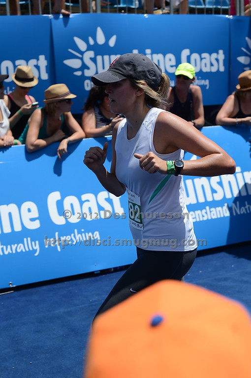 "Approaching the Finish Line - Run Leg  - 2012 Noosa Triathlon, Noosa Heads, Sunshine Coast, Queensland, Australia; 4 November 2012. Photos by Des Thureson. Camera 1. - The images in this gallery have not been edited / cropped. If you purchase* a print or download, these images will be edited / corrected / cropped before being sent out. *Ordering will be via <a href=""http://disci.photoshelter.com"">http://disci.photoshelter.com</a> or via email. Thanks, Des."