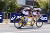 """Tandem Cyclists - Bike Leg - 2012 Noosa Triathlon, Noosa Heads, Sunshine Coast, Queensland, Australia; 4 November 2012. Photos by Des Thureson. Camera 1. - The images in this gallery have not been edited / cropped. If you purchase* a print or download, these images will be edited / corrected / cropped before being sent out. *Ordering will be via <a href=""""http://disci.photoshelter.com"""">http://disci.photoshelter.com</a> or via email. Thanks, Des."""