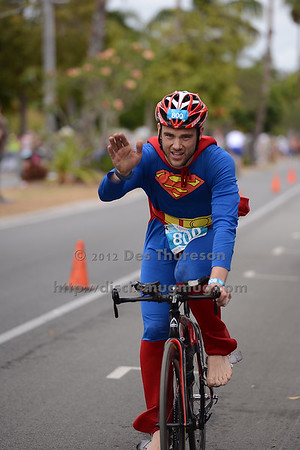 """Superman - Bike Leg - 2012 Noosa Triathlon, Noosa Heads, Sunshine Coast, Queensland, Australia; 4 November 2012. Photos by Des Thureson. Camera 1. - The images in this gallery have not been edited / cropped. If you purchase* a print or download, these images will be edited / corrected / cropped before being sent out. *Ordering will be via <a href=""""http://disci.photoshelter.com"""">http://disci.photoshelter.com</a> or via email. Thanks, Des."""