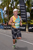 "Run Leg - 2012 Noosa Triathlon, Noosa Heads, Sunshine Coast, Queensland, Australia; 4 November 2012. Photos by Des Thureson. Camera 1. - The images in this gallery have not been edited / cropped. If you purchase* a print or download, these images will be edited / corrected / cropped before being sent out. *Ordering will be via <a href=""http://disci.photoshelter.com"">http://disci.photoshelter.com</a> or via email. Thanks, Des."