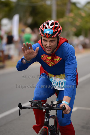 "Superman - Bike Leg - 2012 Noosa Triathlon, Noosa Heads, Sunshine Coast, Queensland, Australia; 4 November 2012. Photos by Des Thureson. Camera 1. - The images in this gallery have not been edited / cropped. If you purchase* a print or download, these images will be edited / corrected / cropped before being sent out. *Ordering will be via <a href=""http://disci.photoshelter.com"">http://disci.photoshelter.com</a> or via email. Thanks, Des."