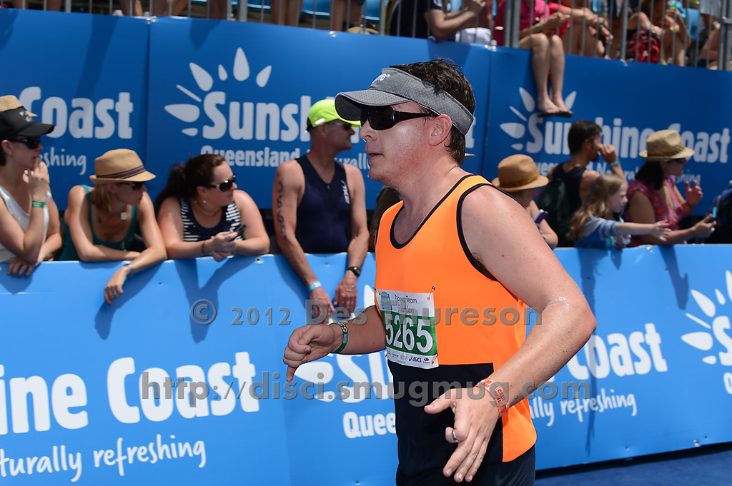 """Approaching the Finish Line - Run Leg  - 2012 Noosa Triathlon, Noosa Heads, Sunshine Coast, Queensland, Australia; 4 November 2012. Photos by Des Thureson. Camera 1. - The images in this gallery have not been edited / cropped. If you purchase* a print or download, these images will be edited / corrected / cropped before being sent out. *Ordering will be via <a href=""""http://disci.photoshelter.com"""">http://disci.photoshelter.com</a> or via email. Thanks, Des."""