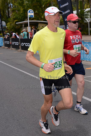"""Run Leg - 2012 Noosa Triathlon, Noosa Heads, Sunshine Coast, Queensland, Australia; 4 November 2012. Photos by Des Thureson. Camera 1. - The images in this gallery have not been edited / cropped. If you purchase* a print or download, these images will be edited / corrected / cropped before being sent out. *Ordering will be via <a href=""""http://disci.photoshelter.com"""">http://disci.photoshelter.com</a> or via email. Thanks, Des."""