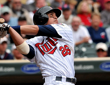 Minnesota Twins' Jose Morales hits an RBI double in the sixth inning against the Cleveland Indians in a baseball game Wednesday, Sept. 22, 2010, in Minneapolis, scoring Alexi Casilla. Morales had three RBIs in the Twins' 5-1 victory. (AP Photo/St. Paul Pioneer Press, John Doman) ** MINNEAPOLIS OUT **
