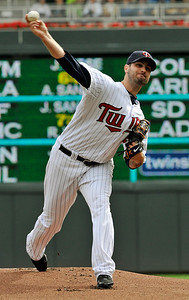 Minnesota Twins pitcher Nick Blackburn works against the Cleveland Indians in the first inning of a baseball game Wednesday, Sept. 22, 2010,  in Minneapolis. (AP Photo/Jim Mone)