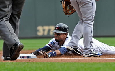 Minnesota Twins' Alexi Casilla slides into third with a triple against Cleveland Indians pitcher Carlos Carrasco in the first inning of a baseball game Wednesday, Sept. 22, 2010,  in Minneapolis. (AP Photo/Jim Mone)