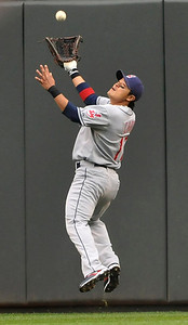 Cleveland Indians right fielder Shin-Soo Choo of Korea goes up to field a deep fly ball  for an out off the bat of Minnesota Twins' Denard Span in the fifth inning of a baseball game Wednesday, Sept. 22, 2010,  in Minneapolis. (AP Photo/Jim Mone)
