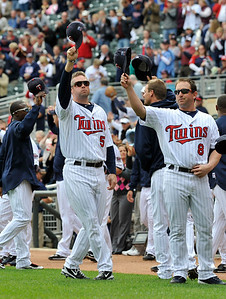 Minnesota Twins players, including Michael Cuddyer (5) and Nick Punto (8) made a curtain call to the crowd prior to the baseball game against the Cleveland Indians Wednesday, Sept. 22, 2010 in Minneapolis. The Twins won the American League Central Division Tuesday night with a win over the Indians and a White Sox loss to the Athletics. (AP Photo/Jim Mone)