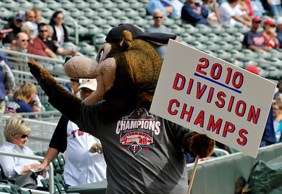 TC, the Minnesota Twins mascot, carrys a champions sign prior to the baseball game against the Cleveland Indians Wednesday, Sept. 22, 2010,  in Minneapolis.  The Twins won the American League Central Division Tuesday night with a win over the Indians and a White Sox loss to the Athletics. (AP Photo/Jim Mone)