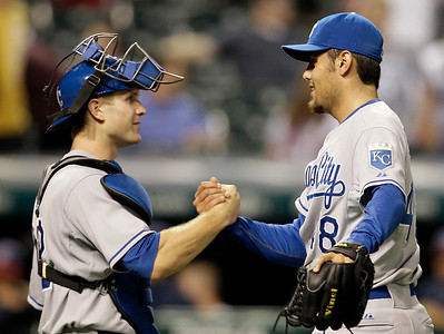 Kansas City Royals relief pitcher Joakim Soria, right, is congratulated by catcher Lucas May after they defeated the Cleveland Indians 4-2 in a baseball game, Thursday, Sept. 23, 2010, in Cleveland. (AP Photo/Tony Dejak)