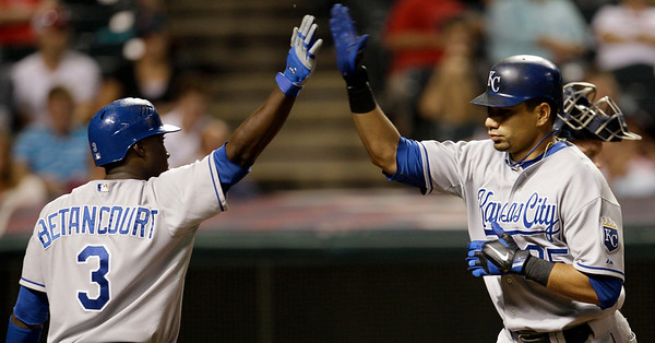 Kansas City Royals' Kila Ka'aihue, right, is congratulated by teammate Yuniesky Betancourt after hitting a solo home run off Cleveland Indians relief pitcher Tony Sipp in the eighth inning in a baseball game, Thursday, Sept. 23, 2010, in Cleveland. (AP Photo/Tony Dejak)