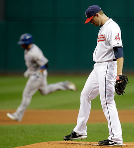 Cleveland Indians starting pitcher Mitch Talbot, right, waits for Kansas City Royals' Mike Aviles to run the bases after Aviles hit a solo home run in the first inning in a baseball game, Thursday, Sept. 23, 2010, in Cleveland. (AP Photo/Tony Dejak)