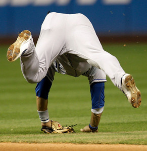 Kansas City Royals second baseman Mike Aviles balances himself after trying to field a ball hit by Cleveland Indians' Trevor Crowe in the sixth inning in a baseball game, Thursday, Sept. 23, 2010, in Cleveland. Crowe was safe at first base. (AP Photo/Tony Dejak)