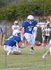Trinity Valley High School kicker Pepa Regan kicks a field goal for the Trojans.  #2 Carter Lea holds.