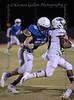 Trinity Valley High School LB #56 Hudson Jamison wraps up #3 Woodlands Christian RB Roric Hawkins, Jr.